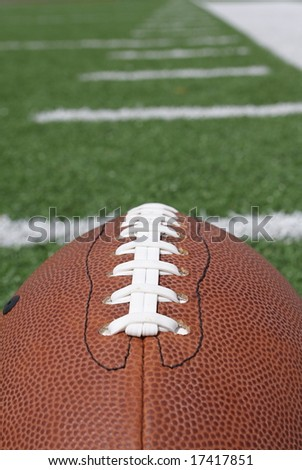 Football laces and the field - stock photo