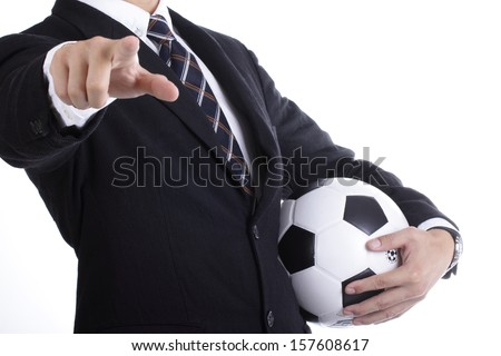 Football manager hold ball for command player for follow as planning - stock photo