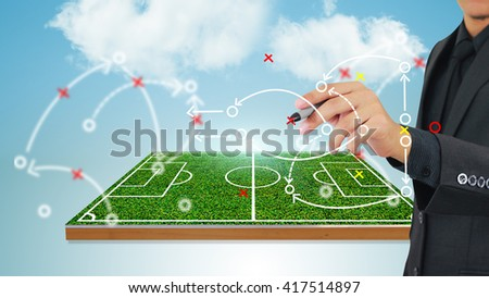 Football manager plan tactics  - stock photo