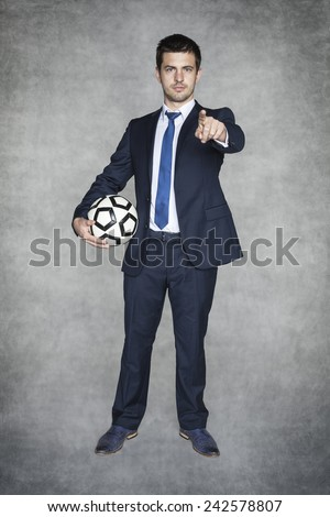 Football manager pointing at you - stock photo