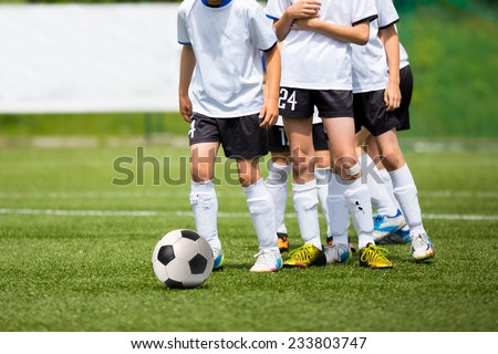 Football match for children. Boys playing training and football soccer tournament - stock photo