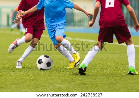 Football match for children. Training and football soccer game tournament - stock photo