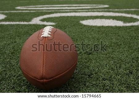 Football near the 50 - stock photo