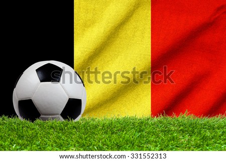 Football on grass field with wave flag of Belgium - stock photo