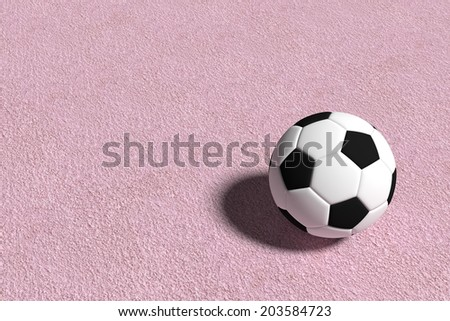 Football on pink ground - stock photo