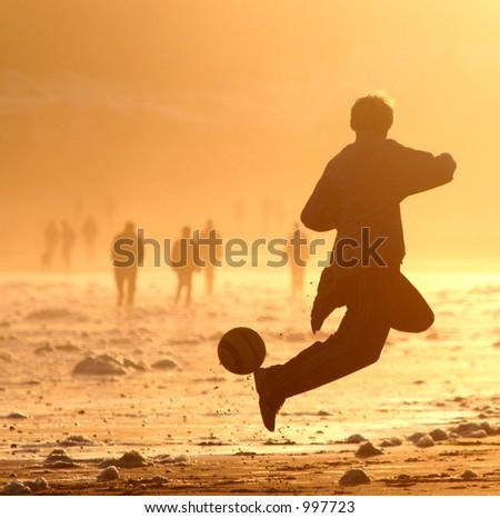Football on the Beach - stock photo