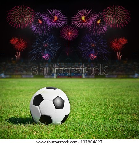 Football on the field with stadium and firework background - stock photo