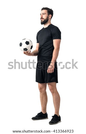 Football or soccer futsal player holding ball in one hand looking up. Full body length portrait isolated over white background.  - stock photo