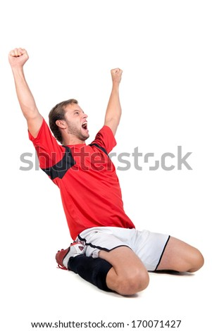 Football player celebrating a goal isolated in white - stock photo