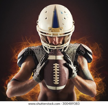 Football player holding ball in his hands - stock photo