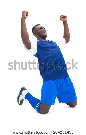 Football player in blue celebrating a win on white background - stock photo