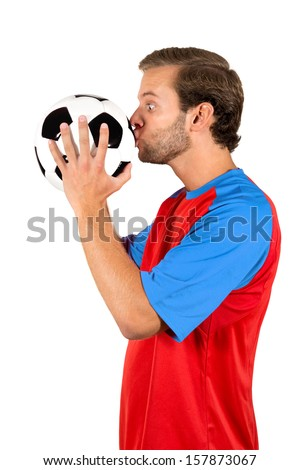 Football player kissing a ball isolated in white - stock photo