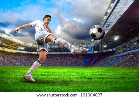 Football player on field of stadium - stock photo