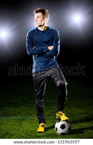 football player on grass field. Sport portrait. - stock photo