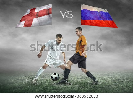 Football player on soccer field of stadium. Match between two countries. - stock photo