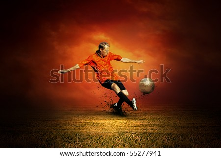 Football player on the outdoors field - stock photo