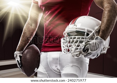 Football Player with a red uniform on a Locker room. - stock photo