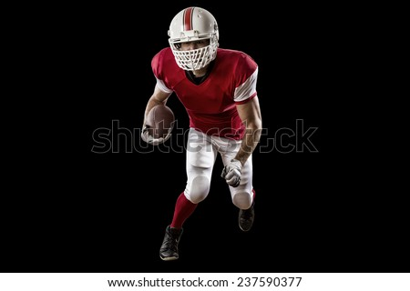 Football Player with a red uniform Running on a Black background. - stock photo