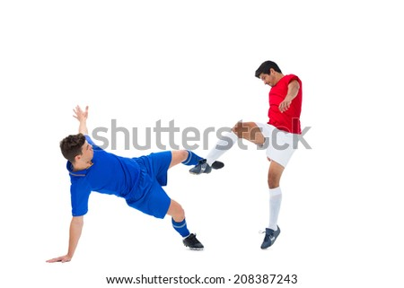 Football players tackling for the ball on white background - stock photo
