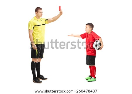 Football referee showing red card to a junior soccer player isolated on white background - stock photo