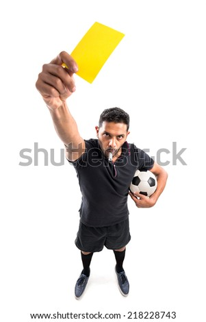 Football referee whistling and showing yellow card, view from above - stock photo