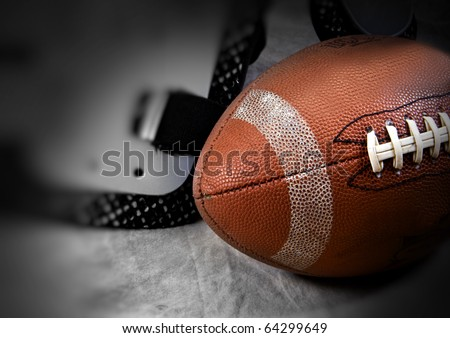 Football set on a tan set with soft focus and copy space - stock photo