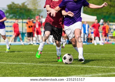 football soccer game. competition between two running players - stock photo