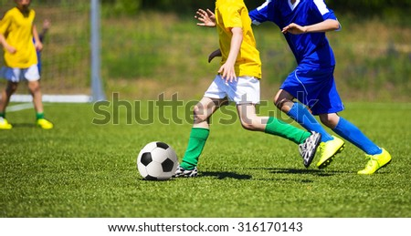 Football soccer game. Players footballers running and playing football match - stock photo