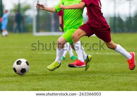 Football soccer match. Boys playing soccer game  - stock photo