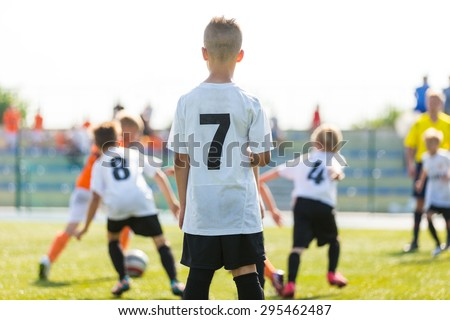 Football soccer match for children. Kids waiting on a bench. Boys support team. Penalty extra time.  - stock photo