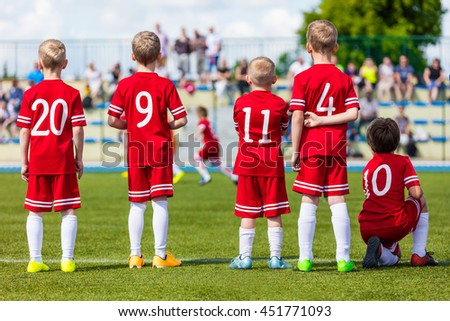 Football soccer match for children. Youth football soccer team on sport stadium. Sports school tournament for children.  - stock photo