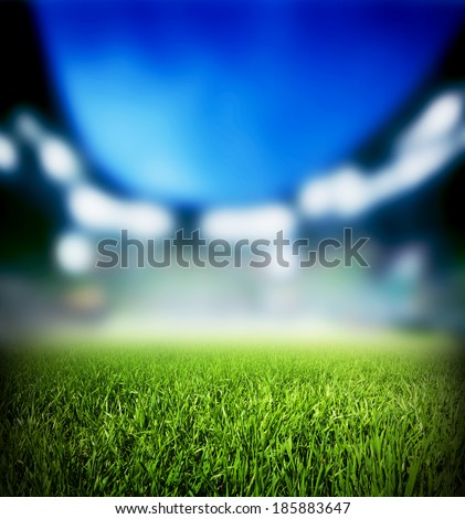 Football, soccer match. Grass close up. Night event lights on the stadium. - stock photo