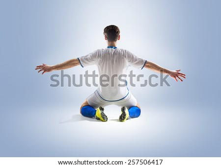 football soccer player in action  isolated color background - stock photo