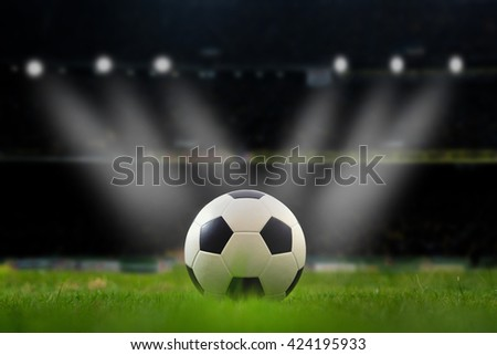 football stadium before the game, soccer lighting, soccer field, soccer stadium, soccer on grass,  soccer team, soccer sport, soccer ball, soccer at night, soccer arena. - stock photo