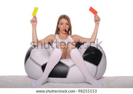 Football supporter with red and yellow cards on white background - stock photo
