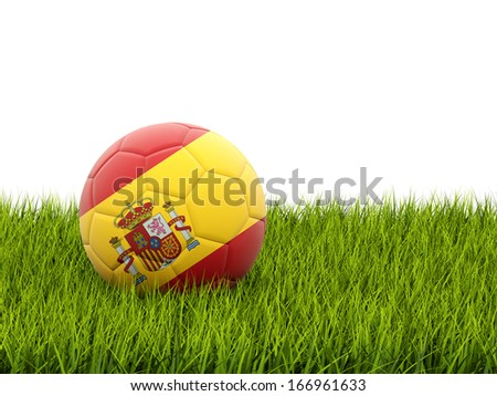 Football with flag of spain on green grass - stock photo