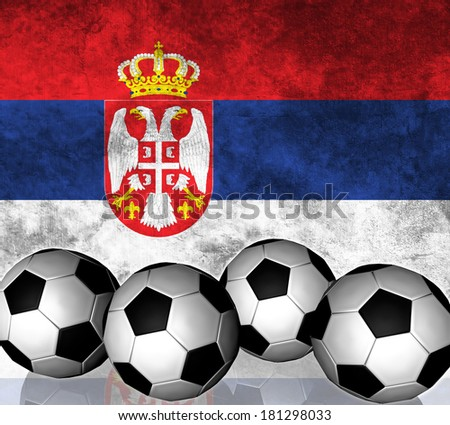 Footballs on top of flag - Serbia - stock photo