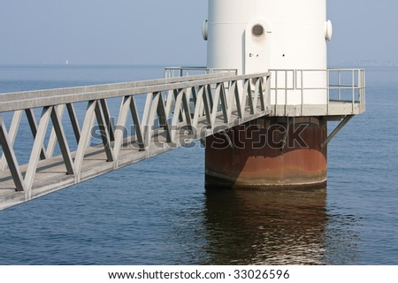 Footbridge for maintenance of windmill in the Netherlands - stock photo