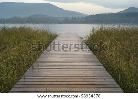 Footbridge on the loch Banyoles - stock photo