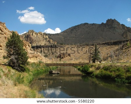 footbridge over the crooked river, Smith Rock State Park, Oregon - stock photo