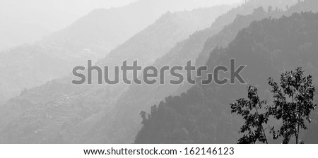 Foothills of the Himalayas in the fog - Nepal (black and white) - stock photo