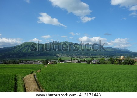 footpath in rice fields around Mt.Aso - stock photo