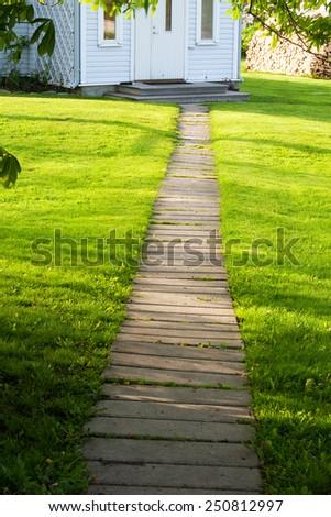 Footpath near a house - stock photo