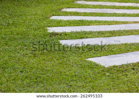 Footpath with yard in the garden - stock photo