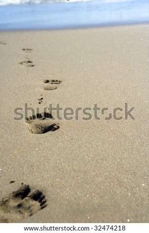 Footprint in the sand at the beach - stock photo