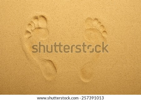 Footprint in the sand. Top view. blur - stock photo