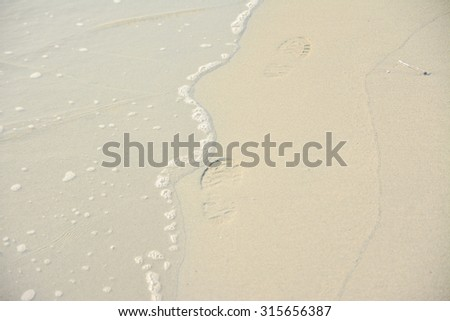 footprint on beach - stock photo