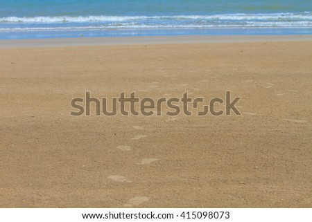 Footprint on sand beach in summer, abstract nature background - stock photo