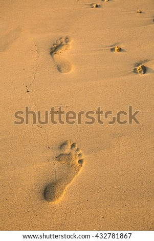 Footprint on the sand beach. - stock photo