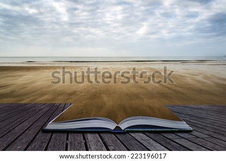 Footprints on empty beach Summer landscape conceptual book image - stock photo
